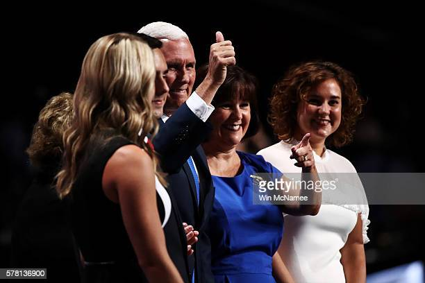 Republican vice presidential candidate Mike Pence gives a thumbs up to the crowd while accompanied by his mother Nancy Pence Sarah Whiteside Michael...