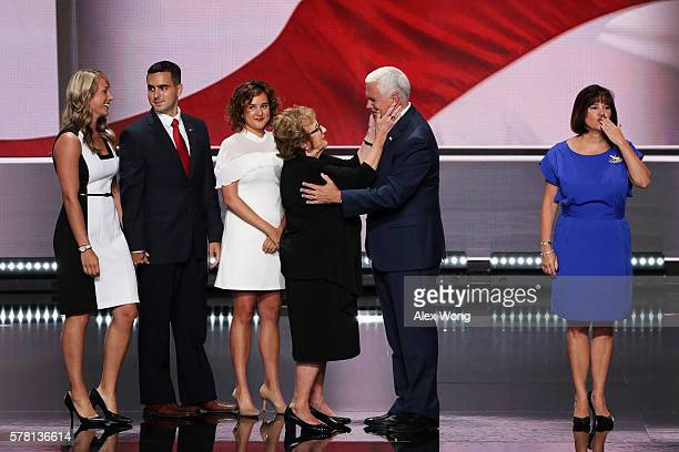 Republican vice presidential candidate Mike Pence is embraced by his mother Nancy Pence and is accompanied by Sarah Whiteside Michael Pence wife...
