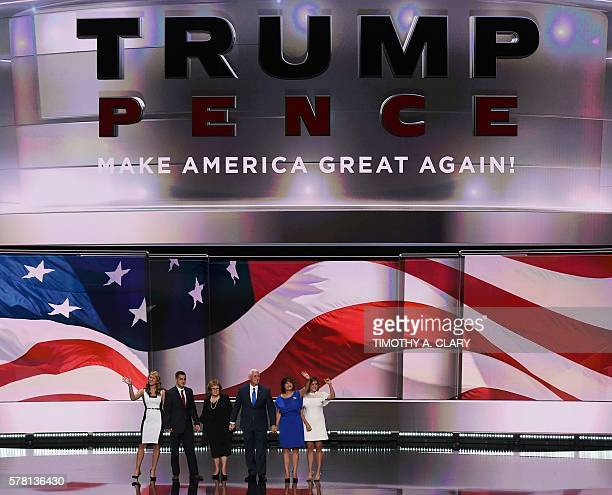 Republican vice presidential candidate Mike Pence is greeted by his family after his speech on day three of the Republican National Convention at the...