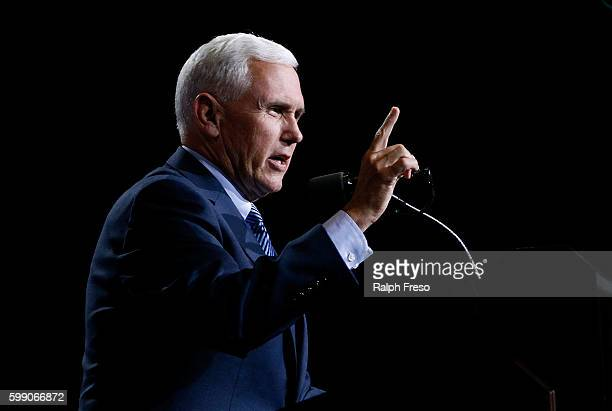 Republican vice presidential candidate Mike Pence speaks to a crowd of supporters at a campaign rally for presidential candidate Donald Trump on...