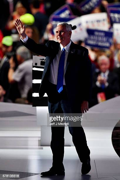 Republican Vice Presidential candidate Mike Pence waves to the crowd as he walks on stage to deliver a speech on the third day of the Republican...