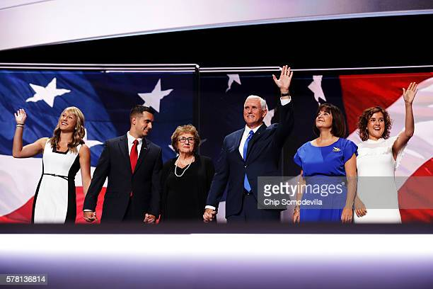 Republican vice presidential candidate Mike Pence waves to the crowd along with his mother Nancy Pence and is accompanied by Sarah Whiteside Michael...