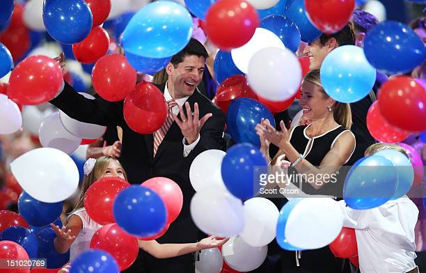 Republican vice presidential candidate US Rep Paul Ryan and wife Janna Ryan stand in the balloon drop during the final day of the Republican National...
