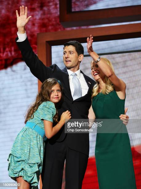 Republican vice presidential candidate US Rep Paul Ryan waves with his wife Janna Ryan and daughter Liza Ryan during the third day of the Republican...