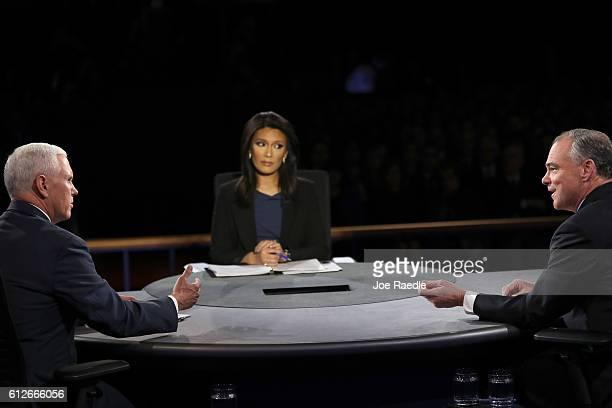Republican vice presidential nominee Mike Pence and Democratic vice presidential nominee Tim Kaine speak as debate moderator Elaine Quijano listens...