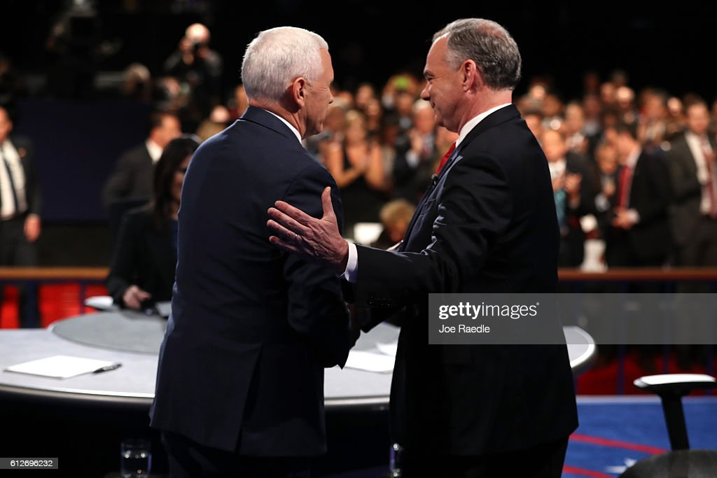 Republican vice presidential nominee Mike Pence and Democratic vice presidential nominee Tim Kaine meet on stage following the Vice Presidential Debate at Longwood University on October 4, 2016 in Farmville, Virginia. This is the second of four debates during the presidential election season and the only debate between the vice presidential candidates.
