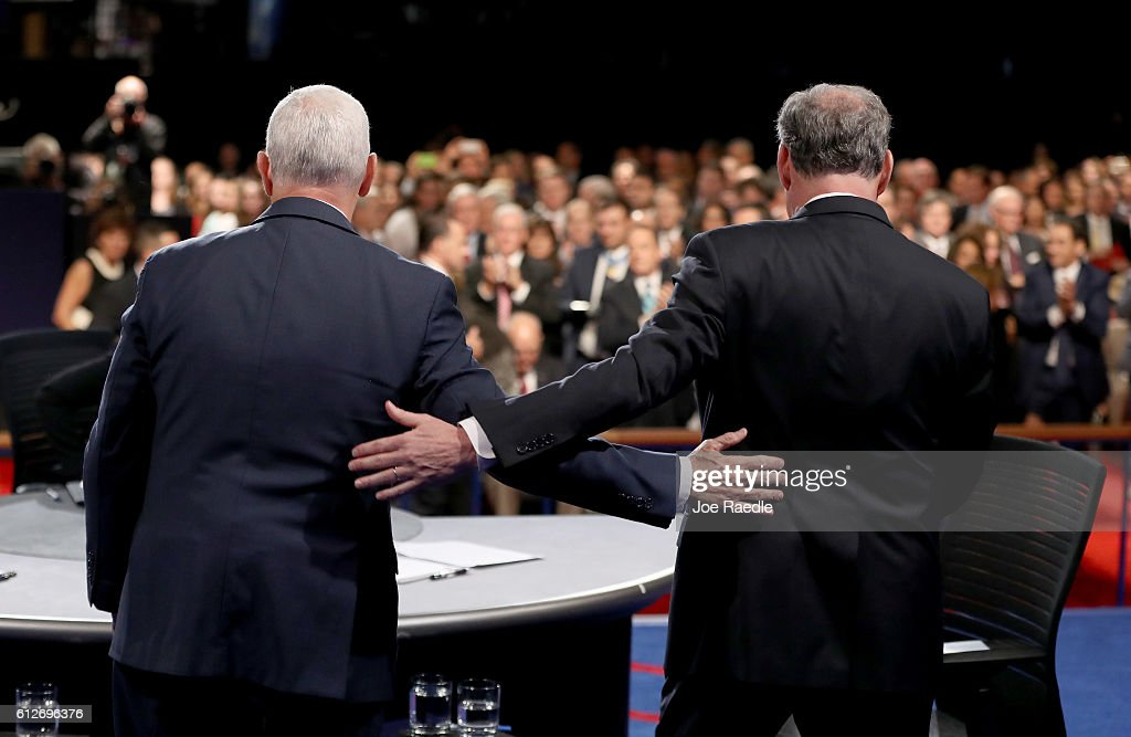 Republican vice presidential nominee Mike Pence and Democratic vice presidential nominee Tim Kaine stand on stage following the Vice Presidential Debate at Longwood University on October 4, 2016 in Farmville, Virginia. This is the second of four debates during the presidential election season and the only debate between the vice presidential candidates.
