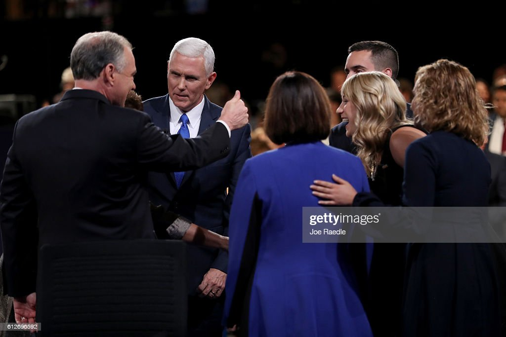 Republican vice presidential nominee Mike Pence (2L) and Democratic vice presidential nominee Tim Kaine (L) meet on stage surrounded by family members following the Vice Presidential Debate at Longwood University on October 4, 2016 in Farmville, Virginia. This is the second of four debates during the presidential election season and the only debate between the vice presidential candidates.