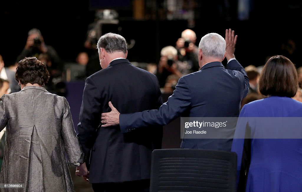 Republican vice presidential nominee Mike Pence (2R) and Democratic vice presidential nominee Tim Kaine (2L) stand on stage with their spouses Karen Pence (R) and Anne Holton (L) following the Vice Presidential Debate at Longwood University on October 4, 2016 in Farmville, Virginia. This is the second of four debates during the presidential election season and the only debate between the vice presidential candidates.