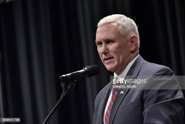Republican vice presidential nominee Mike Pence arrives on stage for a rally with Republican presidential niminee Donald Trump at Stranahan Theater...