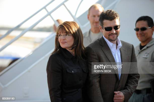 Republican vicepresidential candidate Sarah Palin and her husband Todd Palin prepare to board her campaign plane at the Flagstaff Arizona airport for...