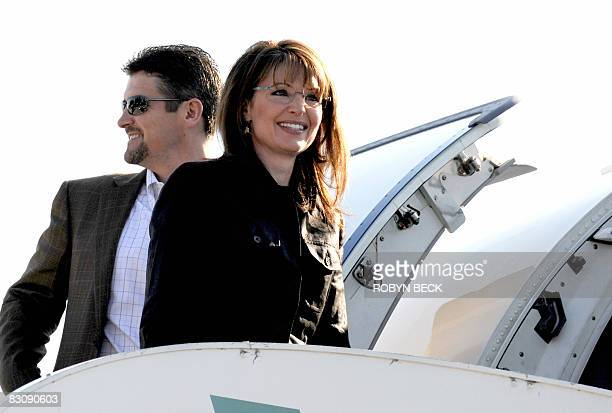 Republican vicepresidential candidate Sarah Palin and her husband Todd Palin prepare to board the campaign plane at the Flagstaff Arizona airport for...