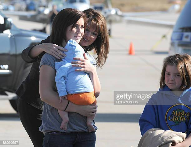 Republican vicepresidential candidate Sarah Palin greets her daughters Willow and Piper at the Flagstaff Arizona airport before boarding her campaign...