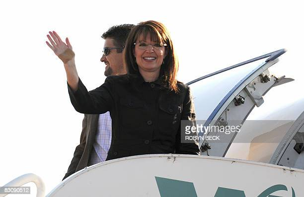 Republican vicepresidential candidate Sarah Palin waves as she and her husband Todd Palin board her campaign plane at the Flagstaff Arizona airport...