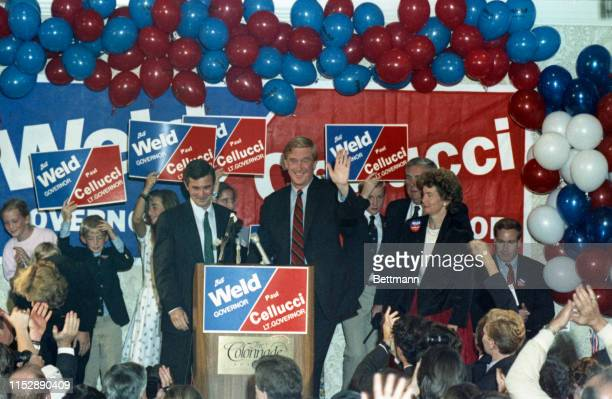 Republican William Weld waves to supporters as he accepts his party's nomination for governor State Senator A Paul Cellucci who claimed victory in...