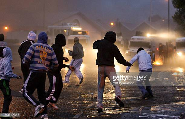 Republican youths attack police Land Rovers during rioting in the Ardoyne area of Belfast. The disturbances followed the annual Twelfth of July...