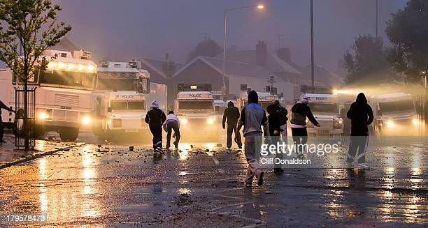 CONTENT] Republican youths throw rocks and bottles at police during rioting at the Ardoyne area of north Belfast Picture Cliff Donaldson