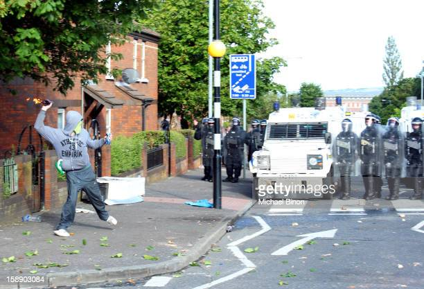 Republicans clash with the police after Loyalist parade passed through Ardoyne on the 12th July 2012. Belfast, Northern Ireland.