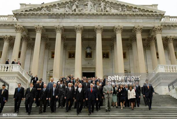 Republicans from the House and Senate walk down the East Front steps outside the House of Representatives for news conference at the US Capitol April...
