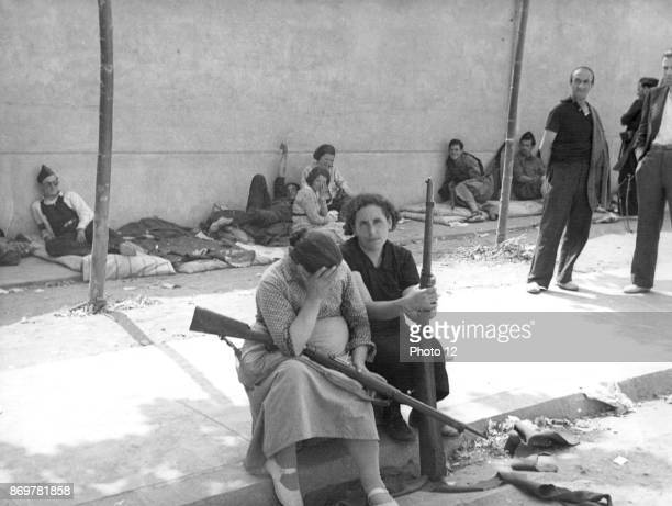 Republicans women with rifles rest during a lull in the Spanish Civil War