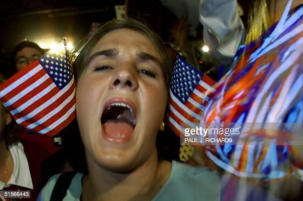 Republician presidential candidate and Texas Governor George W Bush supporter Katie Bradbury of Washington North Carolina screams with the crowd at...