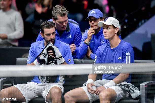 Republic's Tomas Berdych and Croatian Marin Cilic of the Team Europe rest after their match against US Jack Sock and US John Isner of the Team World...