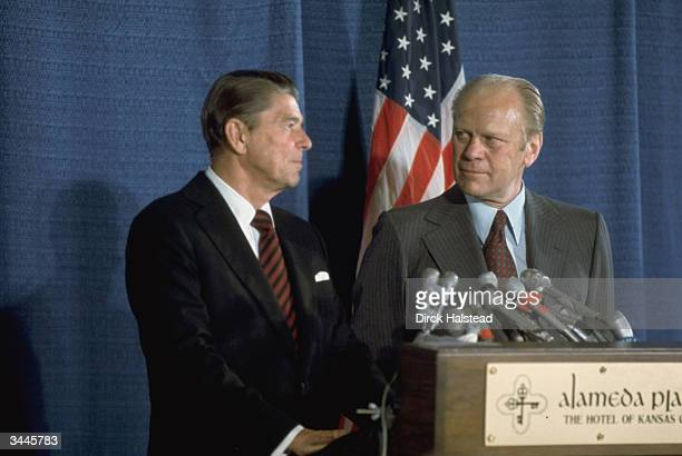 Repulican presidential candidate Ronald Reagan and President Gerald Ford eye each other at a podium during the GOP National Convention Kansas City...