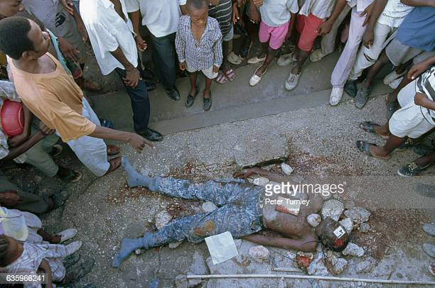 A reputed member of Haiti's rightwing paramilitary squads has been stoned to death in the night a few weeks before the return of exiled President...