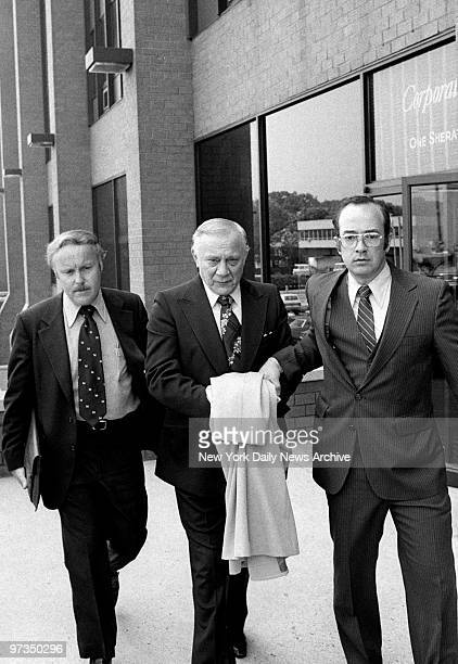Reputed organized crime figure Aniello Dellacroce is escorted from FBI headquarters in New Rochelle
