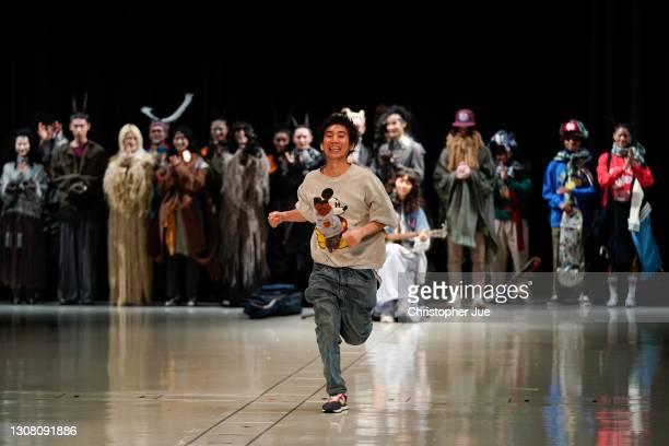 RequaL≡ Designer Tetsuya Doi runs down the catwalk after models showcase his designs during Rakuten Fashion Week TOKYO 2021 autumn/winter at...