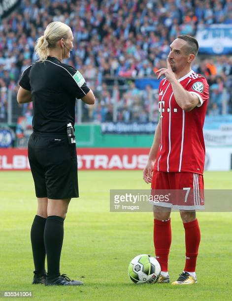 Rerferee Bibiana Steinhaus speak with Franck Ribery of Bayern Muenchen during the DFB Cup first round match between Chemnitzer FC and FC Bayern...