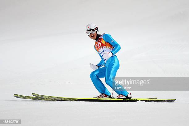 Reruhi Shimizu of Japan lands after a jump during the Men's Normal Hill Individual first round on day 2 of the Sochi 2014 Winter Olympics at the...