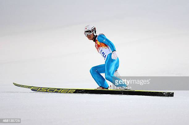 Reruhi Shimizu of Japan lands his jump during the Men's Normal Hill Individual first round on day 2 of the Sochi 2014 Winter Olympics at the RusSki...