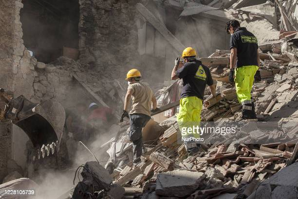 Rescue agency personnel work on the rubble in Amatrice, Italy, on August 24, 2016 damaged by the earthquake.