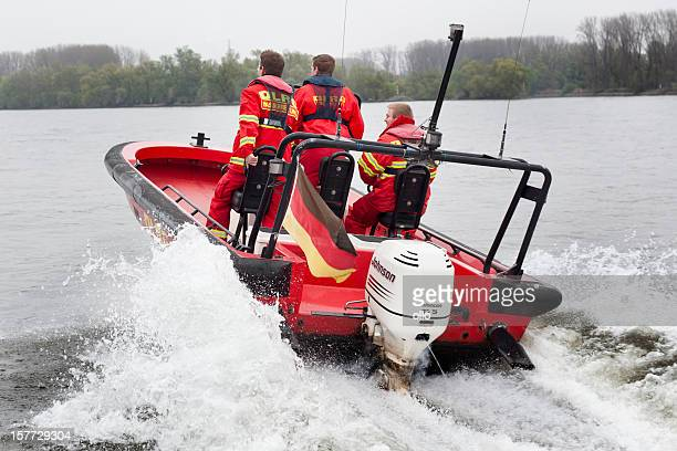 rescue boat and lifeguards of dlrg wasserrettung - lifeboat stock pictures, royalty-free photos & images
