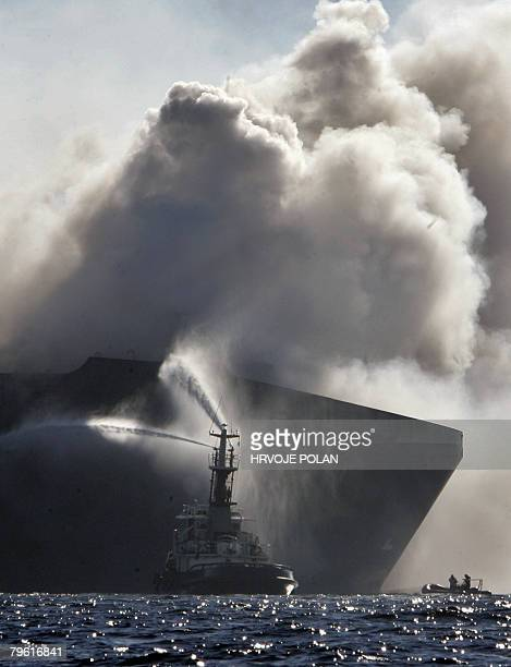 A rescue boat tries to extinguish a fire on February 07 2008 on the Turkey cargo ship which caught fire a day before off the northern Croatian coast...