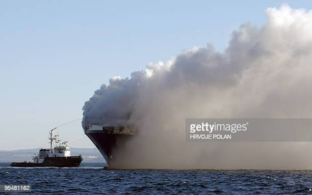 A rescue boat tries to extinguish a fire on February 07 2008 on the Turkey cargo boat which caught fire a day before off the northern Croatian coast...