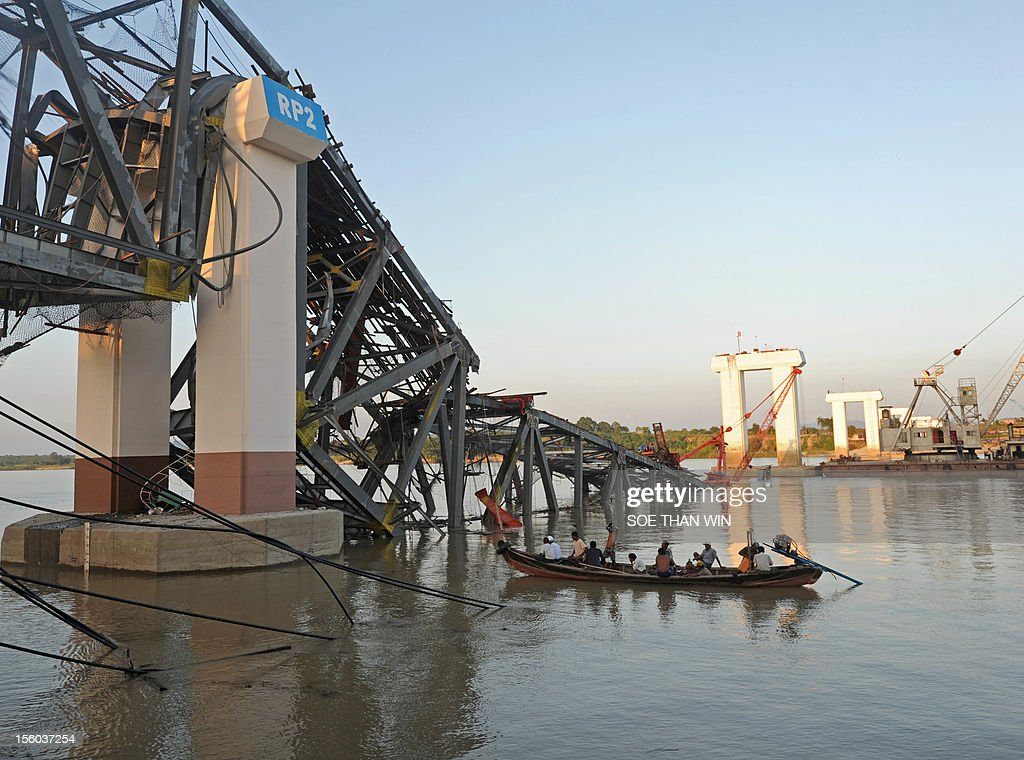 A rescue boat works near a damage bridge in Kyauk Myaung township, east of Shwe Bo, Sagaing division in central Myanmar, following a 6.8-magnitude quake which hit some 116 kilometers (72 miles ) north of the northern Myanmar city on November 11, 2012. A powerful earthquake that struck Myanmar on November 11 left at least two dead and five missing, a government official said, after the tremor sparked panic in Mandalay. AFP PHOTO/ Soe Than WIN