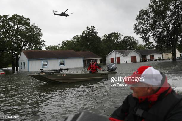 Rescue boats look for people to rescue from their homes by the flooding from Hurricane Harvey on August 30 2017 in Port Arthur Texas Harvey which...