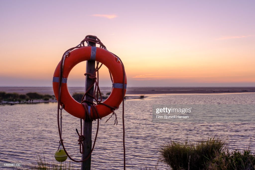 Rescue bouy on the beach of Los Lanches Tarifa : Stock Photo