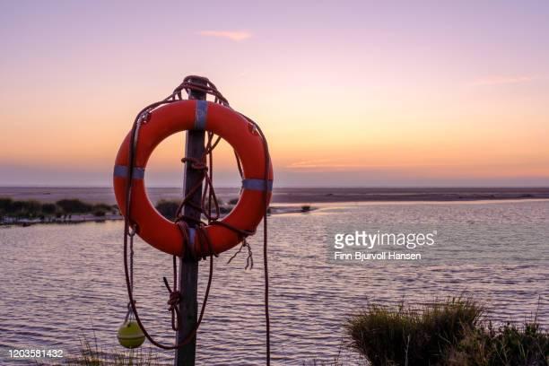 rescue bouy on the beach of los lanches tarifa - finn bjurvoll stock-fotos und bilder