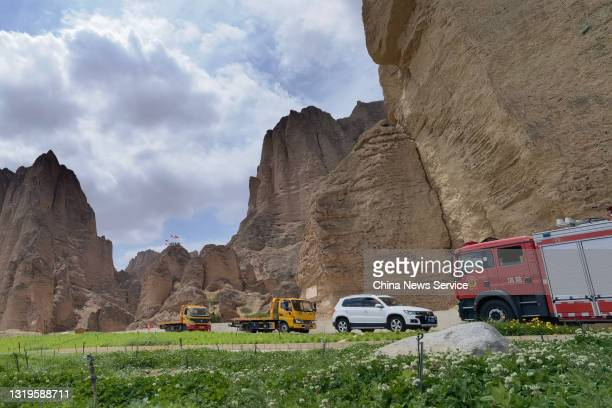 Rescue cars are seen at the Yellow River Stone Forest tourist site of Jingtai County on May 23, 2021 in Baiyin, Gansu Province of China. A 100-km...