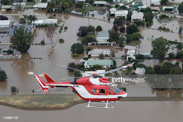 Rescue chopper flying adjacent to Prime Minister Julia Gillard's copper is pictured as she inspects flooding in North Wagga Wagga on March 7, 2012....