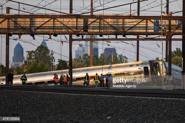 Rescue crews and investigators inspect the site of an Amtrak train derailment in Philadelphia on May 13 2015 At least five people have been killed...