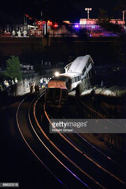 Rescue crews work on the wreckage of two Red Line Metrorail trains that collided with one another between the Fort Totten and Takoma Park stations...