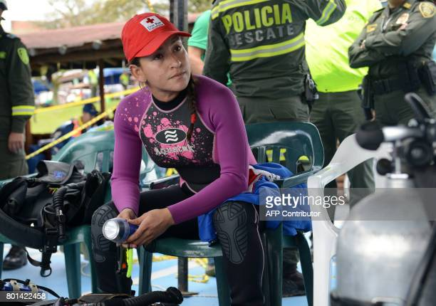 A rescue diver takes a rest during the search of bodies of victims after the tourist boat 'Almirante' sank in the Reservoir of Penol in Guatape...