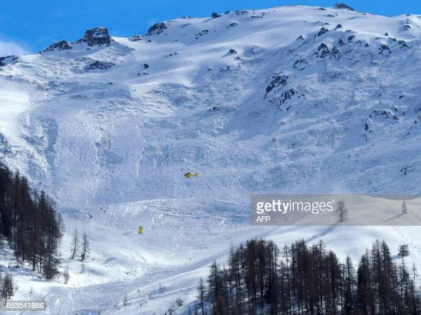 Rescue forces are seen at work in the area of the Jochgrubkopf peak in Tyrol Austria on March 15 2017 As many as four skiers were feared dead on...