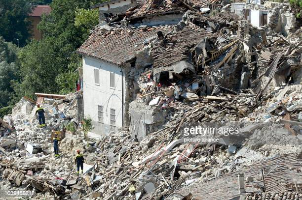 Rescue forces look for victims in the rubble in Pescara del Tronto, Italy, 26 August 2016. A strong earthquake claimed numerous lives in central...