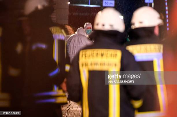 Rescue forces stand near the site where a man drove his car into a carnival procession on February 24 2020 in Volkmarsen near Kassel central Germany...