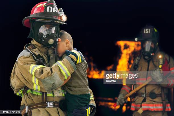 rescue from fire. - fire protection suit stock pictures, royalty-free photos & images